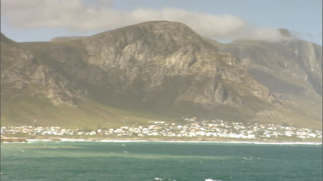 Cliffs rise above the coastal city of Hermanus in the Republic of South Africa.