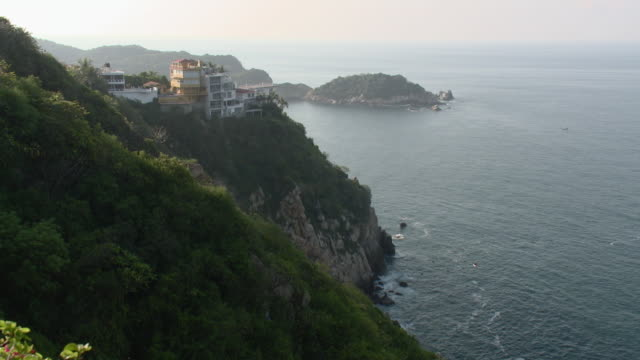 WS HA Cliffs with tourist resorts / Acapulco, Guerrero, Mexico