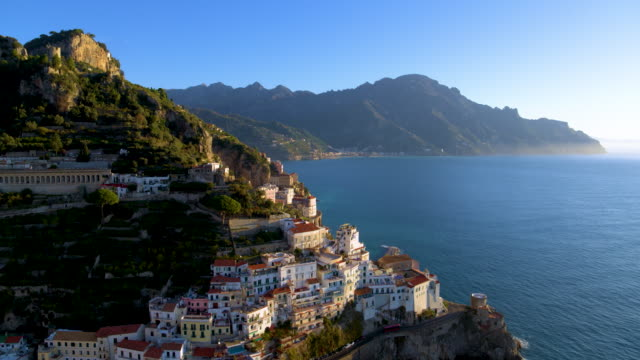 vidéos et rushes de cliffside houses and harbour, amalfi, amalfi coast, italy - italie