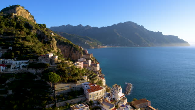 cliffside houses and harbour, amalfi, amalfi coast, italy - italy stock videos & royalty-free footage