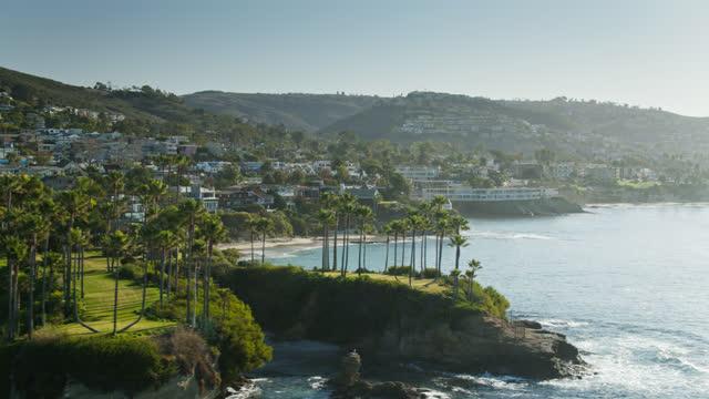 clifftop houses in laguna beach, california - aerial - laguna beach california stock videos & royalty-free footage