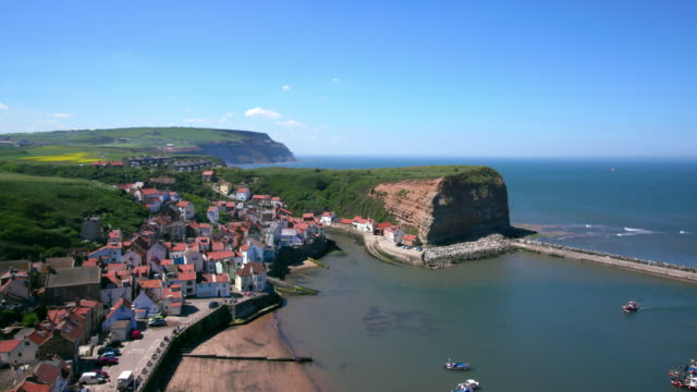 clifftop view of staithes & harbour staithes - establishing shot stock videos & royalty-free footage