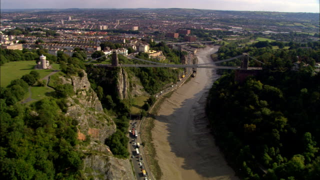 clifton suspension bridge  - aerial view - england, bristol, united kingdom - bristol england stock videos & royalty-free footage