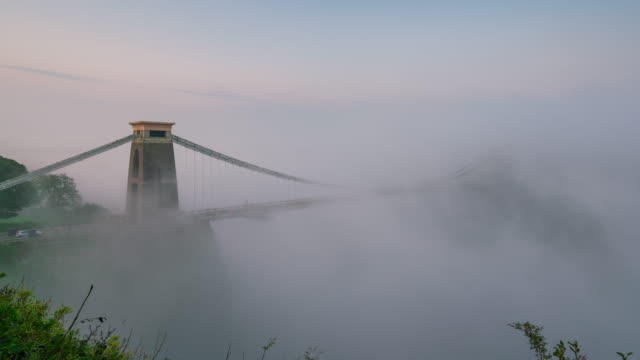 clifton suspension bridge under morning fog in bristol, 4k time-lapse - bristol england stock videos & royalty-free footage