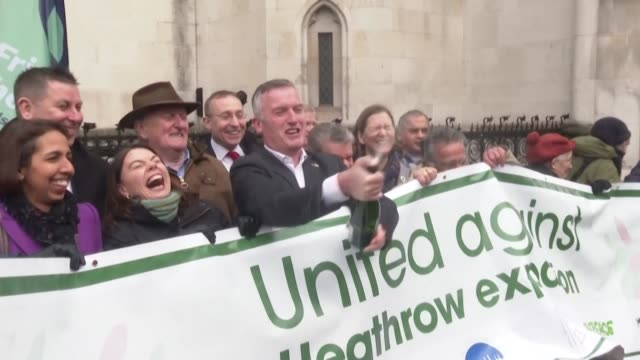 climate activists celebrate outside the royal courts of justice in london after the court of appeals ruled against the building of a third runway at... - paris agreement stock videos & royalty-free footage