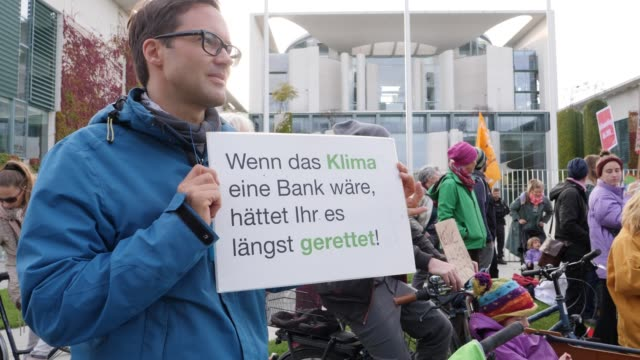 climate activists demanding stronger policies towards bringing down rising global temperatures gather in front of the chancellery on september 19... - aktivist stock-videos und b-roll-filmmaterial