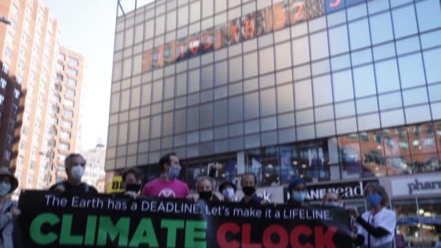 climate activists gather in front of a large climate clock at union square in manhattan as part of climate week nyc with the clock counting down the... - climate finance stock videos & royalty-free footage