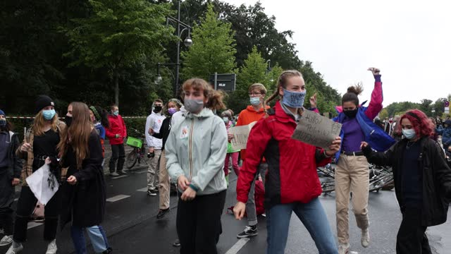 """climate activists gather on a """"global day of action"""" organized by the 'fridays for future' climate change movement during the coronavirus pandemic on... - sustainable energy stock videos & royalty-free footage"""