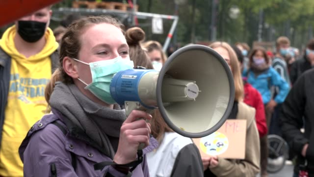 """climate activists gather on a """"global day of action"""" organized by the 'fridays for future' climate change movement during the coronavirus pandemic on... - youth culture stock videos & royalty-free footage"""
