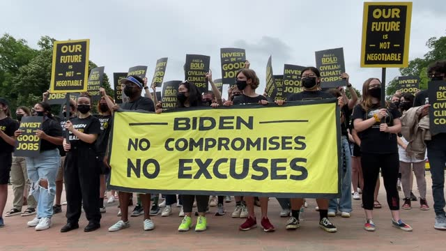 climate activists representing sunrise movement demonstrate outside of the white house calling on president biden to quickly pass a climate friendly... - climate stock videos & royalty-free footage