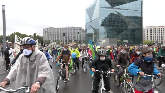 climate activists riding their bicycles during a rally on a global day of action organized by the 'fridays for future' climate change movement during... - climate action stock videos & royalty-free footage