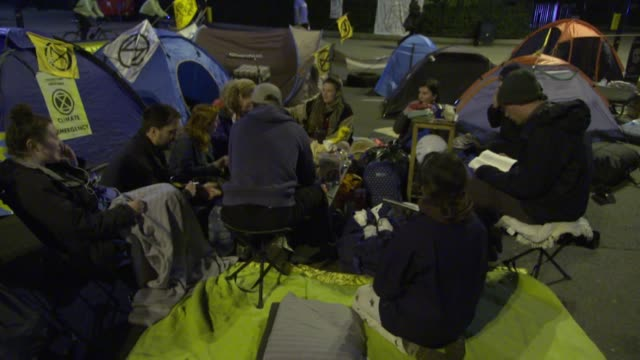 climate change activists extinction rebellion camped out at marble arch in london at night - incidental people stock videos & royalty-free footage