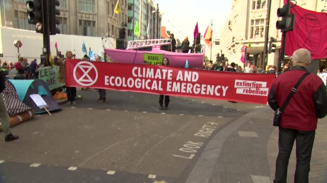climate change activists extinction rebellion protesting at oxford circus london - green stock videos & royalty-free footage