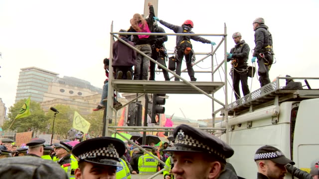 climate change activists from extinction rebellion chained to cars and glued to scaffolding in a bid to bring london to a standstill - bid stock videos & royalty-free footage