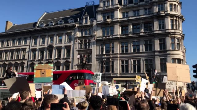 climate change activists have gathered in parliament square to protest with many skipping school to take part - aktivist stock-videos und b-roll-filmmaterial