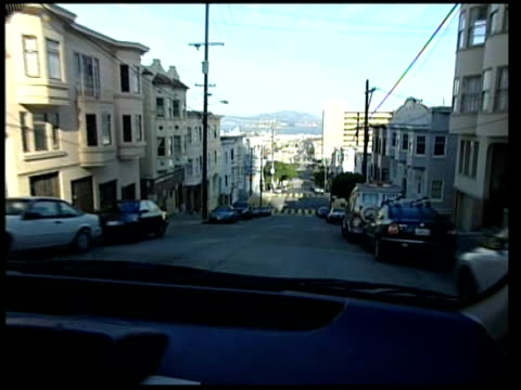 'Big Melt' Report from California INT CAR Irvine at wheel of car as driving through town POV tracking shot down steep hill Close Shot Irvine's face...