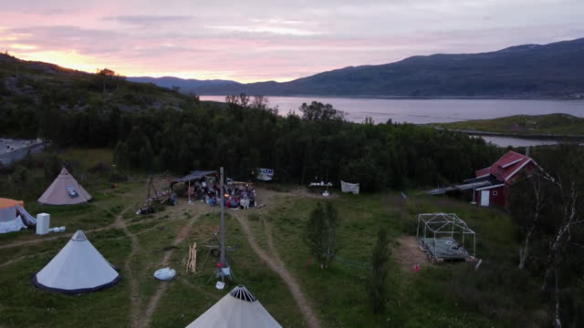 """climate change campaigners camp by fjords in northern norway to protest against opening of cobalt mine - """"bbc news"""" stock videos & royalty-free footage"""