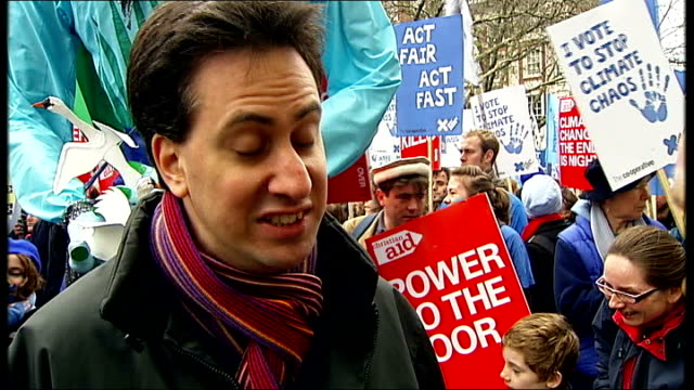 climate change campaigners march in london: ed miliband interview; miliband interview sot - people who dismiss the science are anti-science... - uncertainty stock videos & royalty-free footage