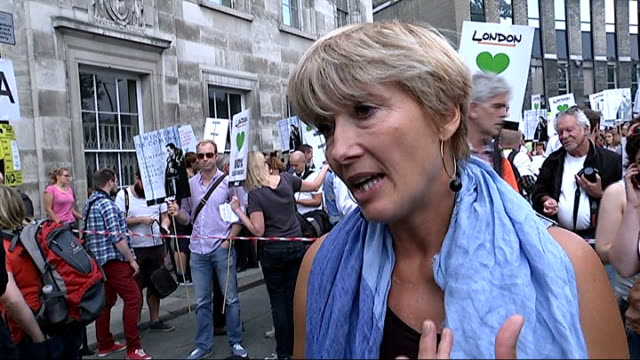 climate change demonstrations before united nations summit; england: london: ext emma thompson interview sot - it's a form of collective suicide /... - エマ・トンプソン点の映像素材/bロール
