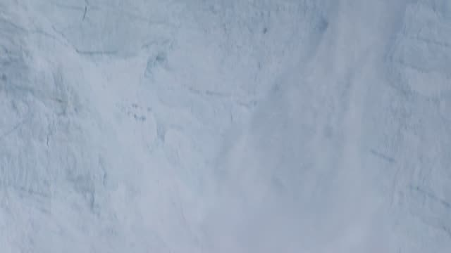 earth on the edge series greenland's melting glaciers greenland ext various shots of pieces of glacier collapsing into sea shot from boat across sea... - crushed ice stock videos & royalty-free footage