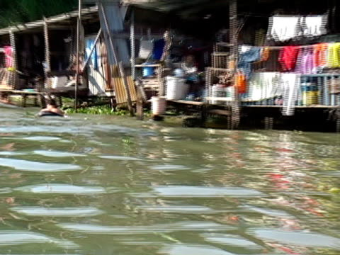climate change, flooding, poverty: living at sea level - boat point of view stock videos and b-roll footage