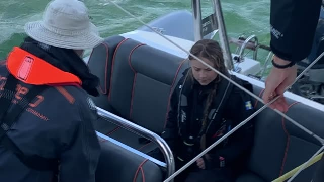 greta thunberg training on yacht off plymouth ahead of atlantic voyage; england: devon: off plymouth: ext / at sea greta thunberg along jetty /... - pier stock videos & royalty-free footage