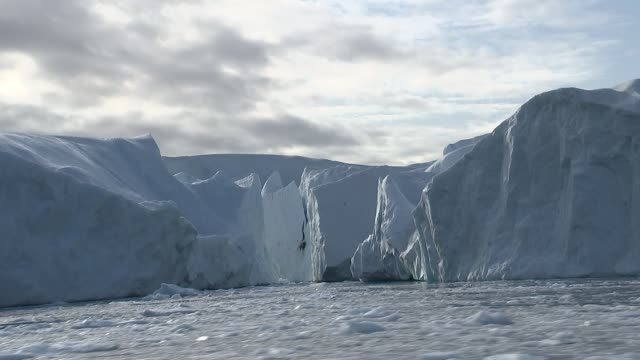 gvs glaciers and whale / town gvs greenland ext pov tracking shots of gvs icebergs ice floes glaciers whale surfacing and diving - surfacing stock videos & royalty-free footage