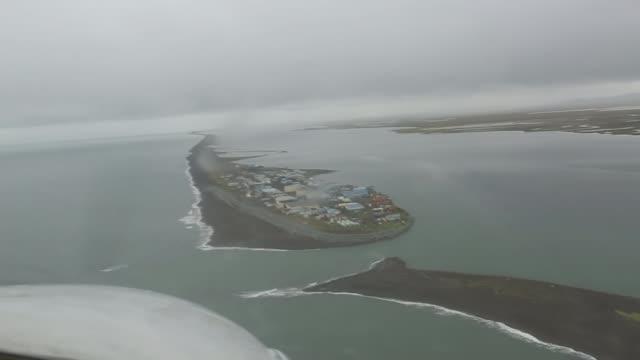 impact on alaskan island of kivalina; usa: alaska: ext air view kivalina - インパクト点の映像素材/bロール