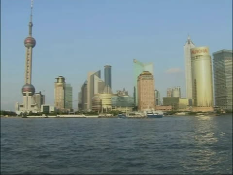 lack of awareness amongst chinese people huangpu river with skyscraper and highrise buildings beyond - river huangpu stock videos & royalty-free footage