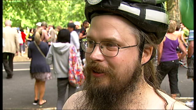 naked bike ride in hyde park; jesse schust interview sot - itv london tonight weekend stock videos & royalty-free footage