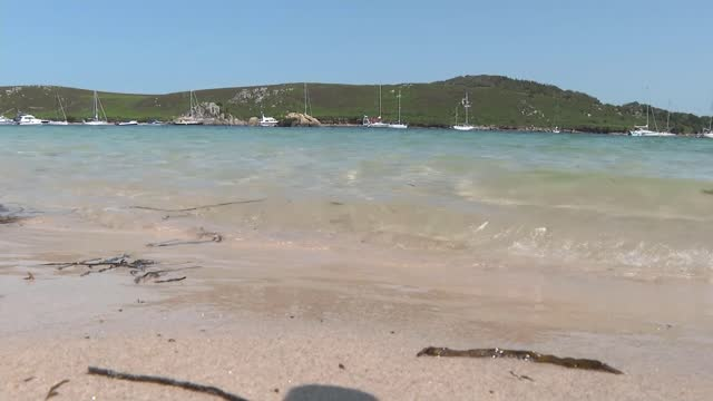 prince charles visits the scilly isles; england: cornwall: scilly isles: ext rocks on sand as tide comes in tide coming in - tide stock videos & royalty-free footage