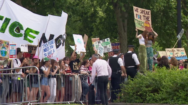 climate change protest outside houses of parliament on the day theresa may resigned as conservative leader - demonstration stock videos & royalty-free footage