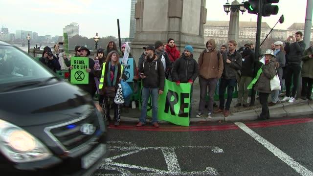 climate change protesters block lambeth bridge england london lambeth lambeth bridge ext various of extinction rebellion climate change protest on... - lambeth stock videos & royalty-free footage