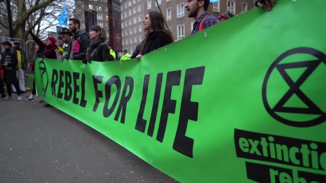 climate change protesters extinction rebellion protest outside the burberry fashion show during london fashion week february 2019 - street style on... - environment stock videos & royalty-free footage