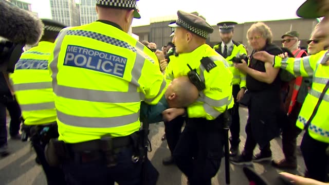 climate change protestor from extinction rebellion being arrested by police on waterloo bridge london - incidental people stock videos & royalty-free footage
