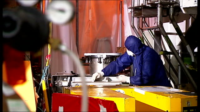 abingdon culham centre for fusion energy int close shot of cordon tape with words 'tritium controlled' illuminated sign 'safe access' 'radioactive... - nuclear fusion stock videos and b-roll footage