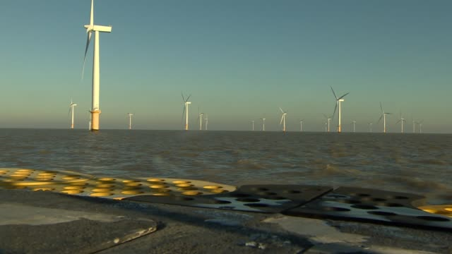 Situation in UK Off the Essex Coast Reporter to camera near offshore wind farm TRACKING SHOTS of wind turbines at Orsted offshore wind farm Location...