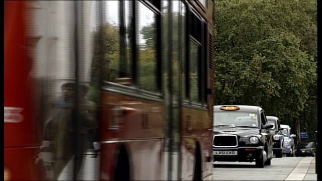 stern report / new bill promised by chancellor ext westminster traffic along outside parliament including cars taxis vans and a bus to aldwych close... - aldwych stock videos and b-roll footage