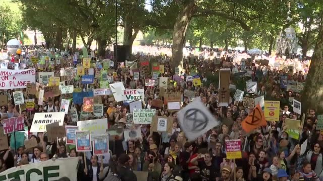 climate demonstrations in westminster england london westminster ext 'keiran' speech sot part 2 of 3 / cutaways of crowd of protesters with banners... - climate stock videos & royalty-free footage