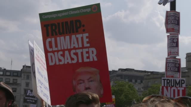 Climate disaster change sign during the protest on Trafalgar square against Trump's visit on July 13 2018 in London England