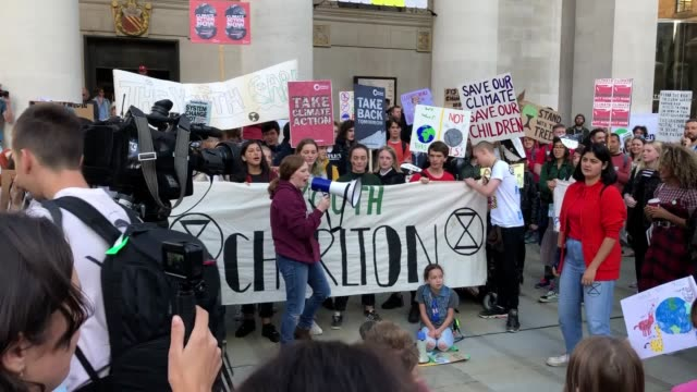 climate protests take place outside manchester's central library as demonstrations are held across the united kingdom some of friday's first protests... - strike protest action stock videos and b-roll footage