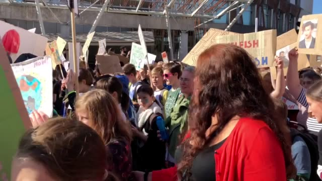 climate strike demonstrators march through edinburgh to the scottish parliament as part of global climate protests schoolchildren and students at... - climate action stock videos & royalty-free footage