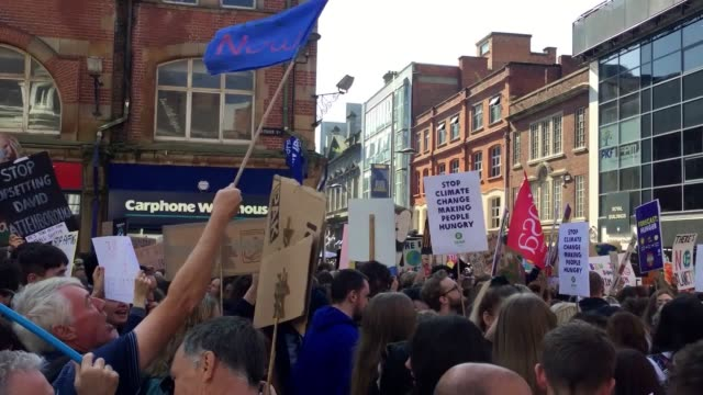climate strike protesters gather en mass in a square in belfast city centre people have taken to the streets across the uk as part of global climate... - strike protest action stock videos and b-roll footage