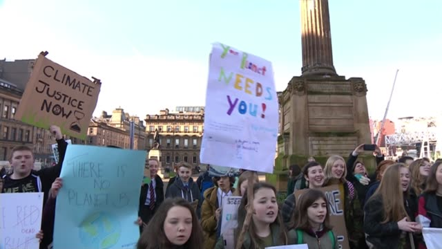 thousands of school pupils march UK protest against climate change SCOTLAND Glasgow George Square Protesters in square chanting SOT