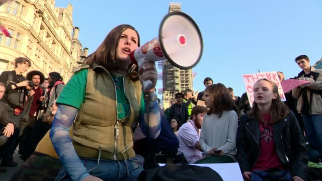 thousands of school pupils march UK protest against climate change ENGLAND London Westminster EXT Various of demonstrators on Whitehall outside...