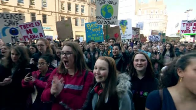 thousands of school pupils march UK protest against climate change ENGLAND South Yorkshire Sheffield Demonstrator addressing crowd SOT PAN crowd of...