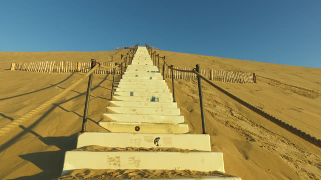 climb the stairs of the pyla dune , a summer morning - dune of pilat stock videos and b-roll footage