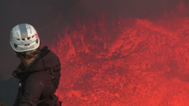 climber admires spectacular volcanic eruption of lava, marum volcano, ambrym island, vanuatu - geologist stock videos & royalty-free footage