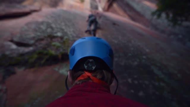 Climber belaying
