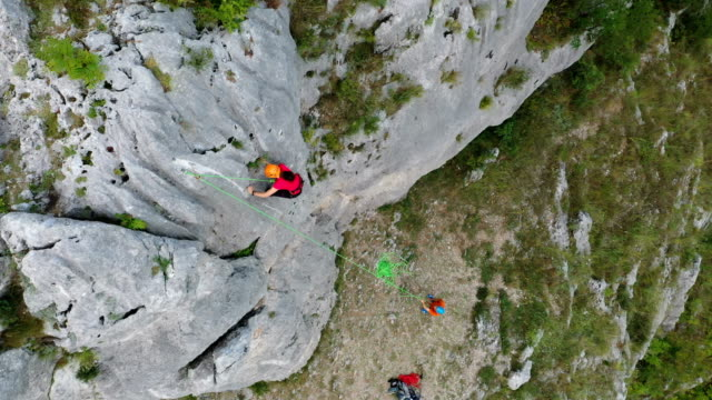 climber climbing on a rock, teamwork - abseiling stock videos & royalty-free footage